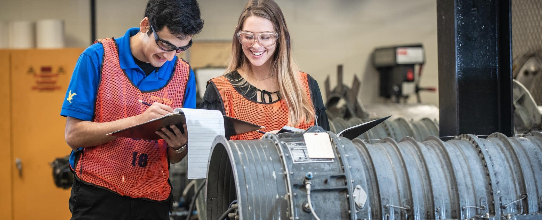students work on an engine