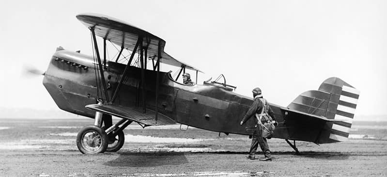 This is a photo of aviator Glenn Curtiss with his biplane.